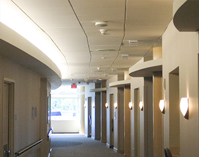 Medical Ceiling Appilication: Traditional accoustical ceiling panels in the hallway of a medical facility