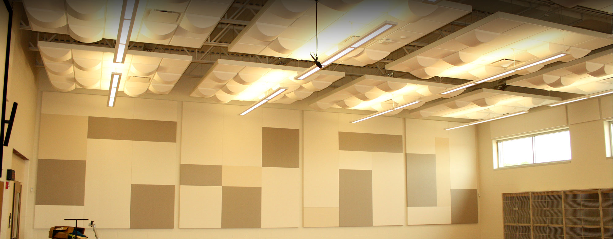 Modern accoustical ceiling panels and wall sound proofing panels in the choir room of a school